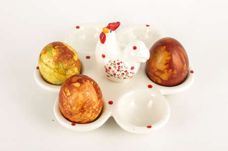 mottle: Easter eggs case with three painter traditional eggs on the bright background Stock Photo