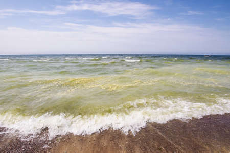 Pollution concept green chemicals in the sea photo
