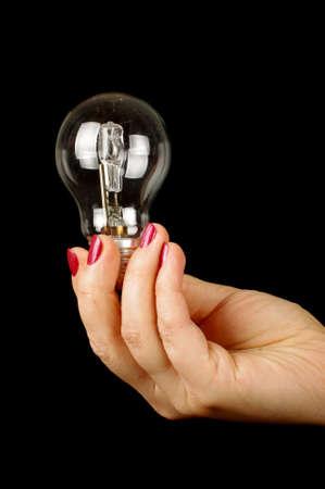 socle: Female hand holding light bulb Stock Photo