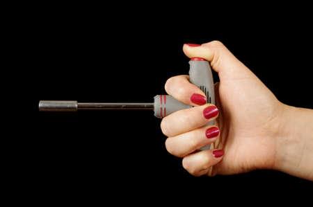 lug: Female hand holding T lug wrench Stock Photo