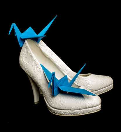 Origami paper cranes on the bridal shoes photo