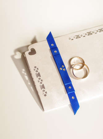 Wedding invitation with two golden rings photo