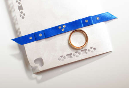 Pair of wedding rings on the wedding invitation card photo