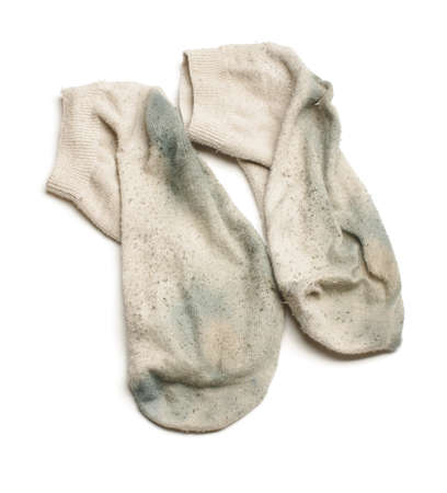 unpleasant: Smelly dirty socks isolated on the white background