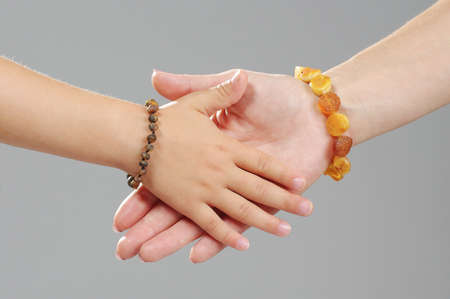 Family concept mother and daughter hands together Stock Photo