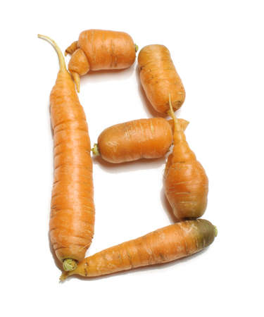 Alphabet letter B arranged from fresh carrots isolated Stock Photo