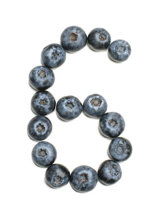 Number 6 arranged from northern highbush blueberry isolated photo