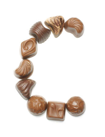 learning series: Alphabet letter C arranged from chocolate sweets isolated Stock Photo