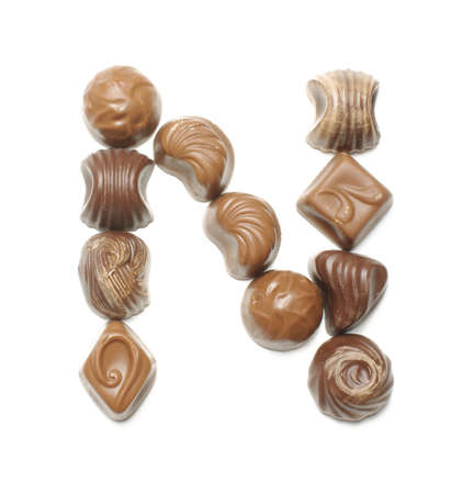 learning series: Alphabet letter N arranged from chocolate sweets isolated