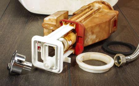 flushing: Broken toilet flushing mechanism Stock Photo