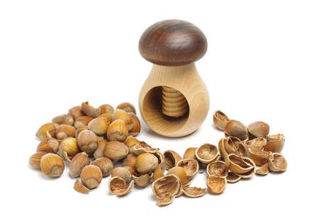 nut cracker: Nut cracker between hazelnuts Stock Photo