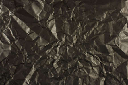 wrinkled paper: Black wrinkled paper texture abstract Stock Photo