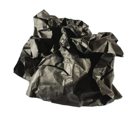 crumpled sheet: Black crumpled sheet of paper isolated on the white background