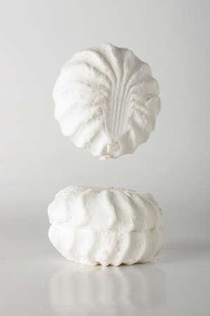 food photography: Marshmallow levitation creative food photography Stock Photo