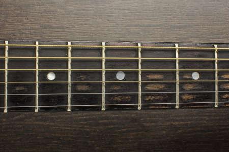 frets: Acoustic guitar frets close up