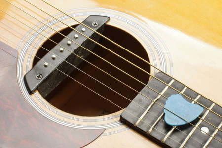 guitar pick: Guitar sound hole and blue guitar pick Stock Photo