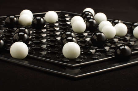 heuristics: Abalone game marble balls on the game board isolated Stock Photo