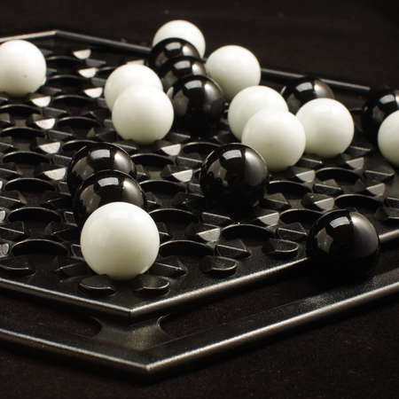 heuristics: Abalone game white and black marble balls