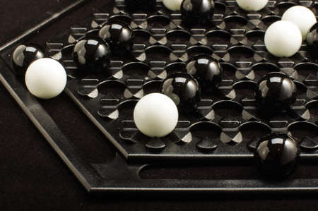 heuristics: Abalone board game close up on the dark background Stock Photo