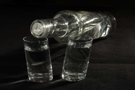 vodka bottle: Vodka bottle and two glass low angle Stock Photo