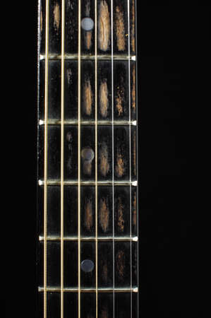 fretboard: Acoustic guitar fretboard isolated on the black background Stock Photo