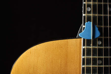 guitar pick: Close up of beautiful guitar body and blue guitar pick
