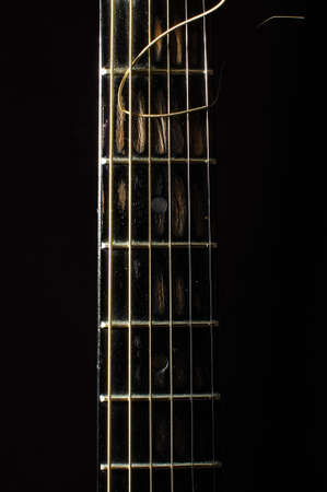 fretboard: Acoustic 6 string guitar fretboard isolated on the black background Stock Photo