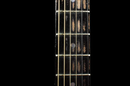 fretboard: Acoustic guitar fretboard isolated with copy space