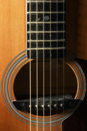 low key lighting: Close up of guitar resonant hole with rosette low key lighting