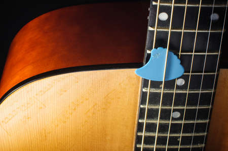 guitar pick: Acoustic guitar body and guitar pick isolated