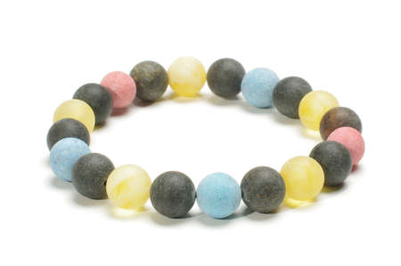 armlet: Multicolor yellow black and blue amber beads armlet isolated on the white background