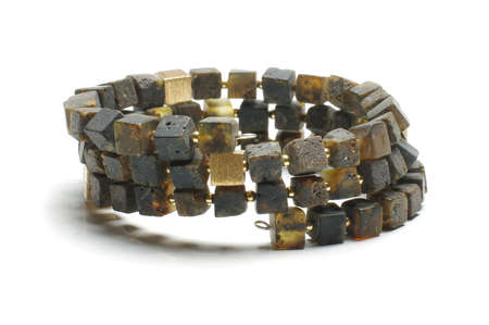 armlet: Dark amber cube armlet isolated on the bright background