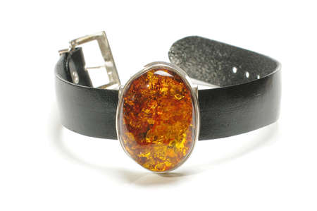 wrist strap: Amber charm on the leather wrist strap isolated