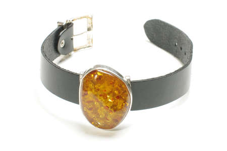 armlet: Big amber inlaid in armlet isolated on the white background Stock Photo