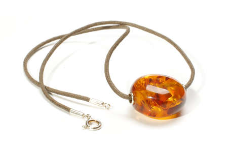 charm: Amber charm isolated on the white background Stock Photo