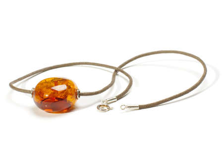 round collar: Natural amber pendant isolated on the white background