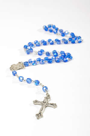 Religion symbol rosary with silver cross isolated