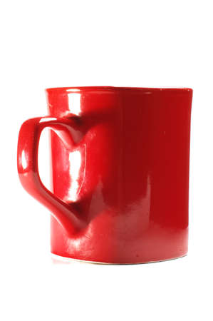 Love concept red mug and handle silhouette shaped heart isolated Stock fotó