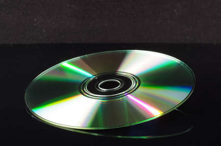 cd rw: Compact disc isolated on the black background with copy space Stock Photo