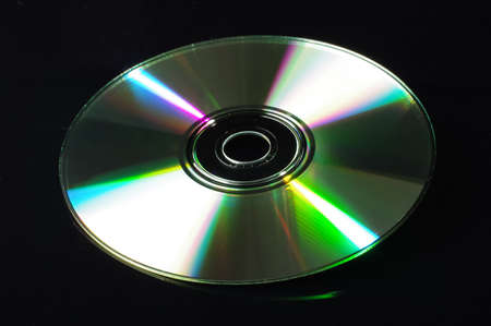 cd rw: Compact disc isolated on the black background