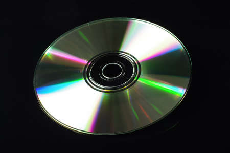 cd rw: Compact disc isolated on the dark background Stock Photo