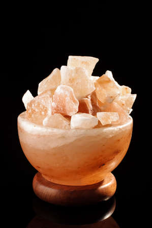 salt lamp: Himalayan salt lamp isolated on the black background with copy space Stock Photo