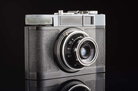 point and shoot: Analog amateur film camera with reflection studio shot Stock Photo