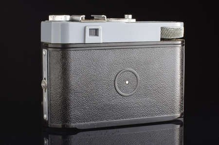 lomography: Old film camera back with viewfinder isolated on the black background