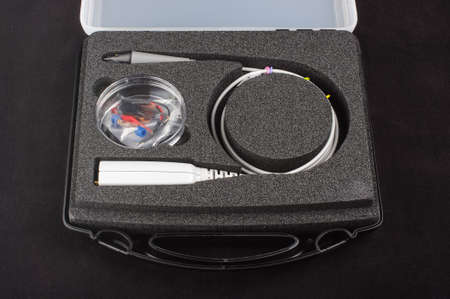 impedance: Electronics oscilloscope probe in the box isolated Stock Photo