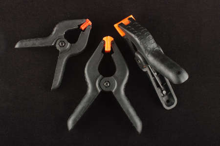 handtools: Three A clamps isolated on the black background
