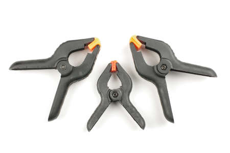 handtools: Three A spring clamps isolated Stock Photo