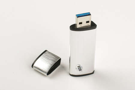 pen drive: Grey metalic aluminum flash pen drive isolated on the bright background