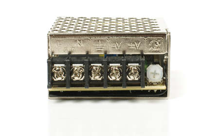 mains: Switching mode power supply isolated on the white background front view with terminal