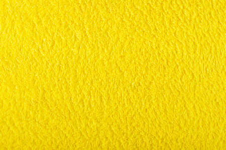 cosiness: Yellow ultra soft sofa blanket abstract surface pattern Stock Photo